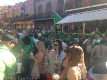A crowd dressed in green in the French Quarter